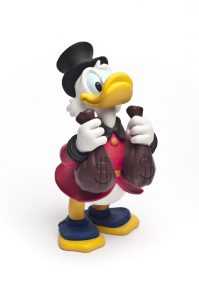 """Catania, Sicily, Italy - October 06, 2011: Studio shot of the Disney cartoon character Scrooge McDuck. This Disney toy."""